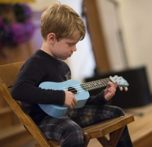 Lukas plays the ukulele at Musicologie